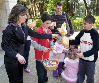 Children Receiving Easter Eggs