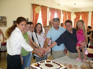 Volunteers Cutting the Cake